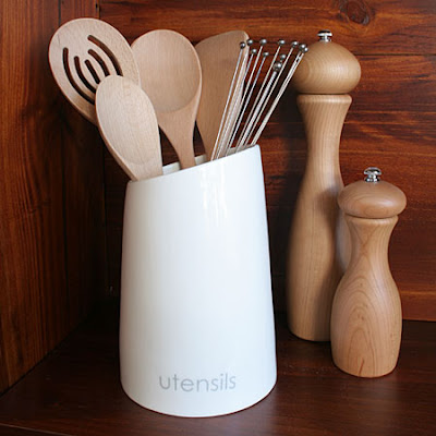 white utensil holder, porcelain - says Utensils