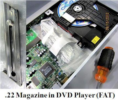 Gun magazine hidden in CD player.