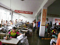 "Clothing Factory: Made in Pyong-sung, but the labels say ""Made in China"""