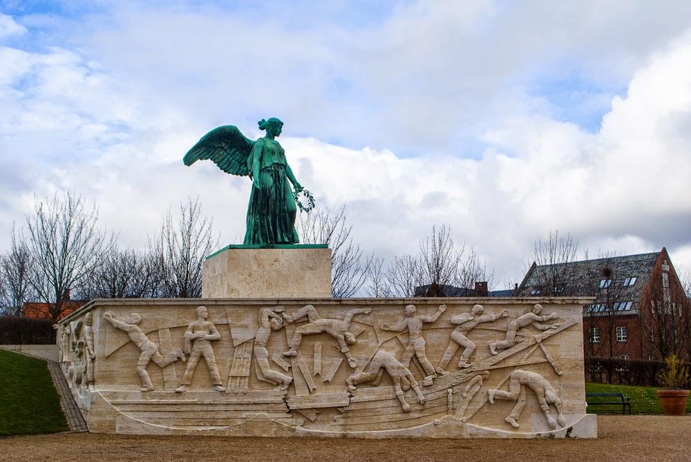 statues near the mermaid in copenhagen, denmar