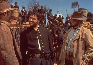 Clint Eastwood wearing a duster in The Good, The Bad, and The Ugly
