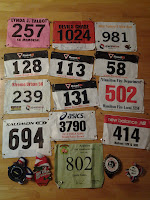 Lance Eaton's racing numbers and medals.