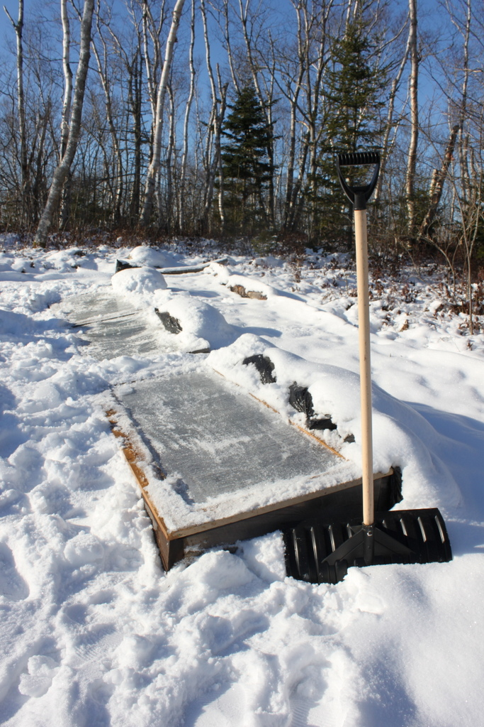 Shovel off the cold frame with a plastic shovel