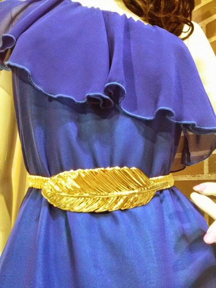 Cinturon pluma metal.