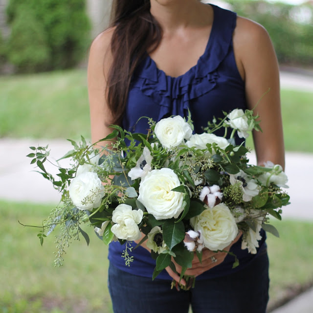 The Brides bouquet was an asymetrical wild organically textured wandering hand tied collection of ranunculus, jasmine, seeded eucalyptus, cotton, camellia, anemone, and alabaster garden roses. sweet pea floral design ann arbor detroit holly rutt misty farms fruitig farms
