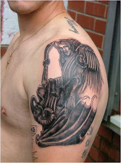 angel slaying devil tattoo