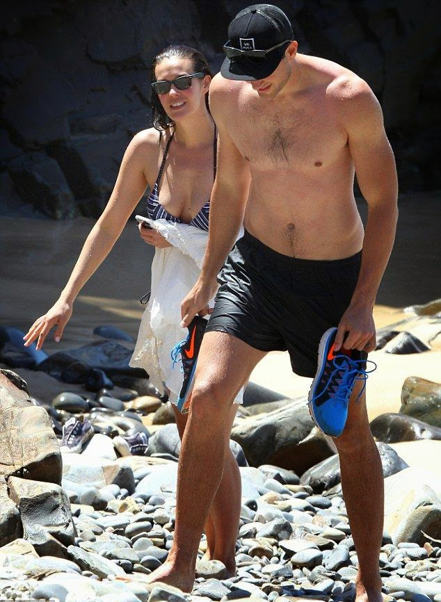 Just looking at her amazing body at Queensland, Australia on Thursday, November 6, 2014, Megan Gale, 39, showed off her fabulous figure in a black bikini.