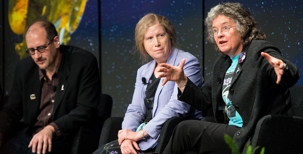 """Dr. David H. Grinspoon (left), Senior Scientist, Planetary Science Institute, Dr. Bonnie Buratti (center), senior scientist at NASA's Jet Propultion Laboratory and Dr. Fran Bagenal, senior scientist at the University of Colorado (right) speaks during a panel discussion at the """"NASA's New Horizons Pluto Mission: Continuing Voyager's Legacy of Exploration"""" event on Monday, August, 25, 2014, in the James E. Webb Auditorium at NASA Headquarters in Washington, DC. The panelists gave their accounts of Voyager's encounter with Neptune and discussed their current assignments on NASA's New Horizons mission to Pluto. Photo Credit: (NASA/Joel Kowsky)"""