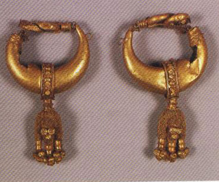 Earrings, Taxila, 1st cent. AD  These earrings, found in an excavation in Sirkap, have a main circle of plain hollowed gold; but notice the fineness of the gold granulation on the pendants, and the clasps in a coil shape.