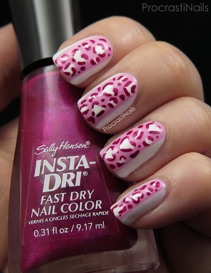 Valentine's Day nail art with heart shaped leopard spots and colour blocking