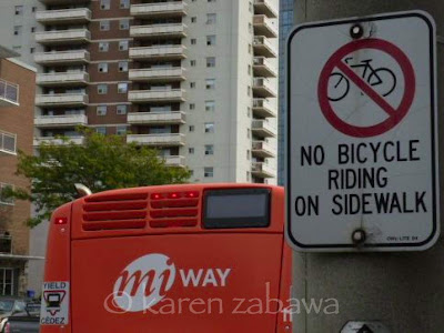Sign says No Cycling on sidewalks in Mississauga.