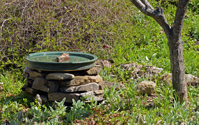 pottery and rock birdbath