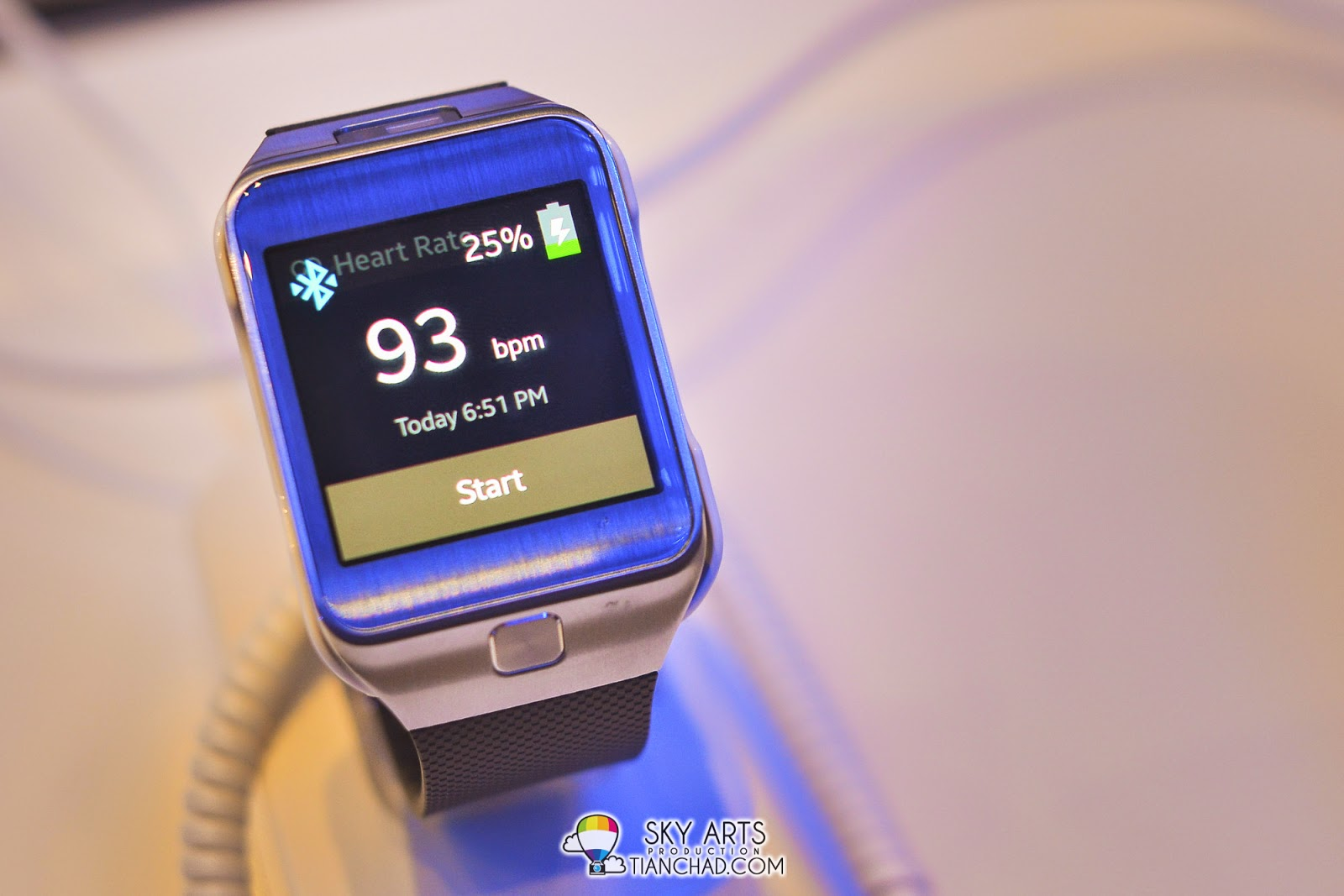 Samsung Gear 2 now have a button at the bottom of the screen instead at the side. Definitely convenient design for us