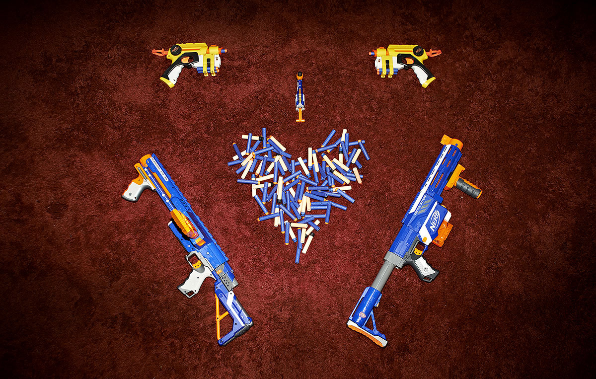 love,valentine's day,nerf,gun,blaster,heart,hurt,enjoy,bibi gun,red,blue,yellow,carpet,amusing,awesome,crazy,awm,photography,real,conceptual,concept