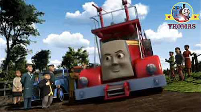 Stand back for red fire truck engine Flynn the champion the Fat Controller watching mass of people