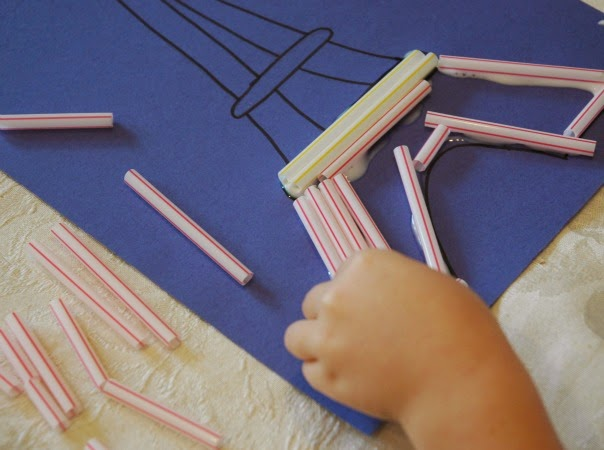 Placing straws on eiffel tower outline