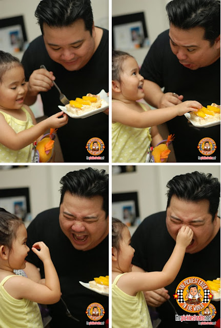 father and daughter eating cake