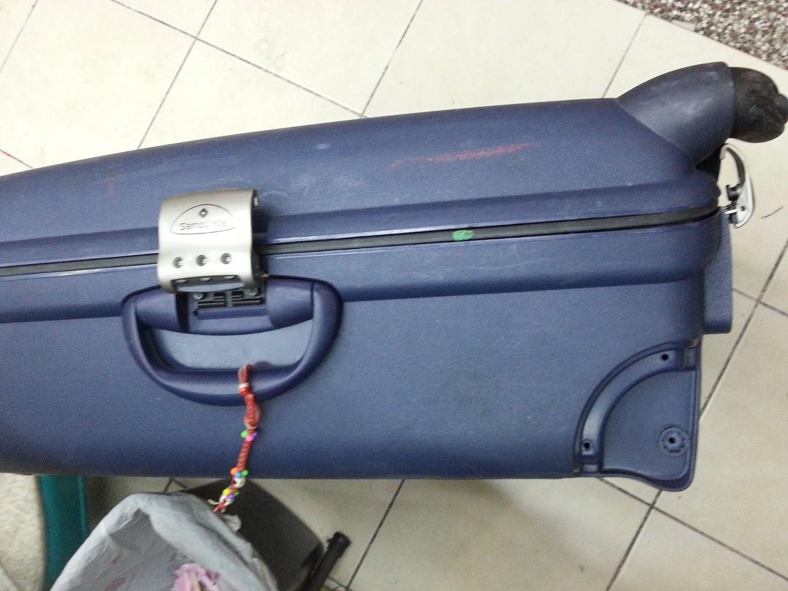 suitcase zipper stuck how to fix