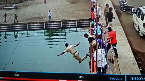A policeman Manoj Barahate, who was on duty at Kumbhmela in Nashik, jumped from a 20-feet tall Amardham bridge to successfully save a drowning man.  A video, which captures Manoj Barahate's bravery, shows a middle-aged man in white shirt moving dangerously close to the edge of the bridge. He tries to cross over the iron railings to jump into the water to end his life.