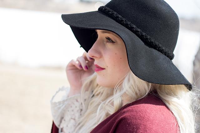 Wool floppy hat & maroon lipstick.
