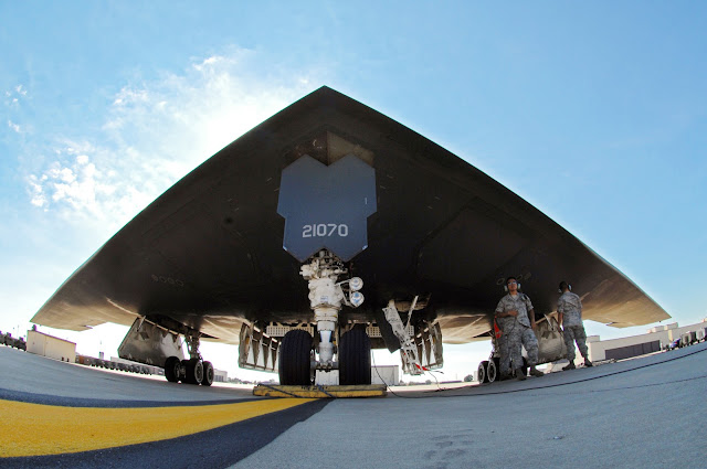 Crew chiefs with the 509th Aircraft Maintenance Squadron prepare a B-2 Spirit for flight
