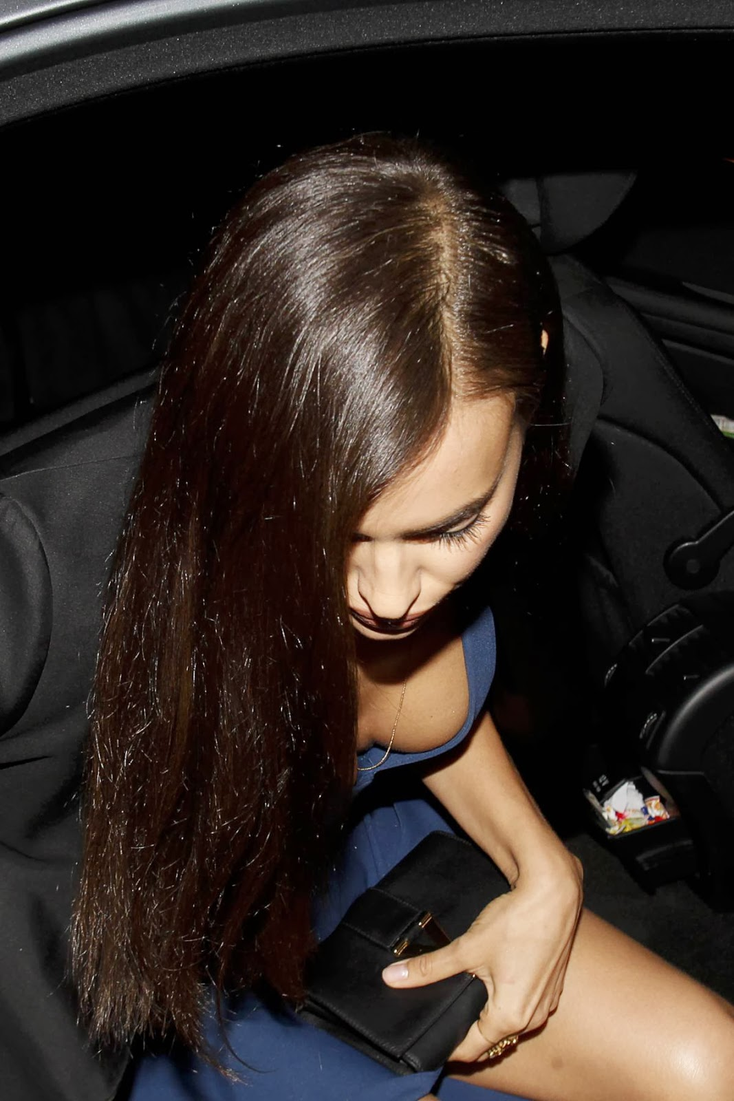 Irina Shayk Cleavage And Legs Candids At Roberto Cavalli Boutique Opening In Milan