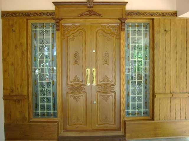 Latest kerala model wooden double doors designs gallery for Front door design in india