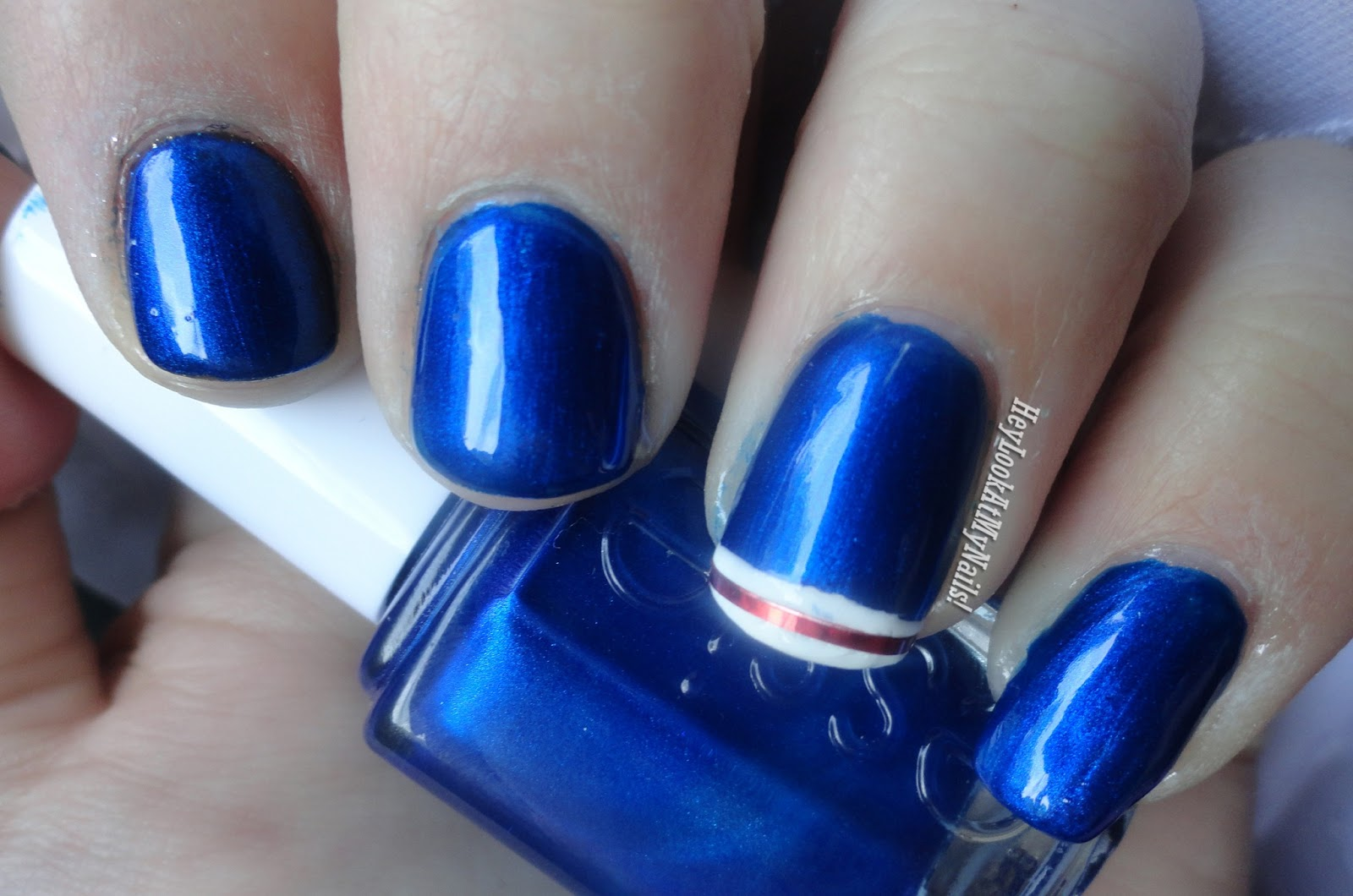 Let S Go Rangers With Essie Aruba Blue And Some Well Placed Striping Tape
