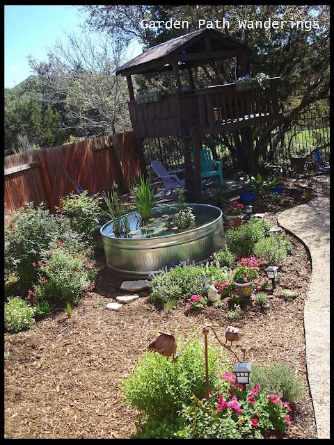 Garden path wanderings stock tank water garden is in