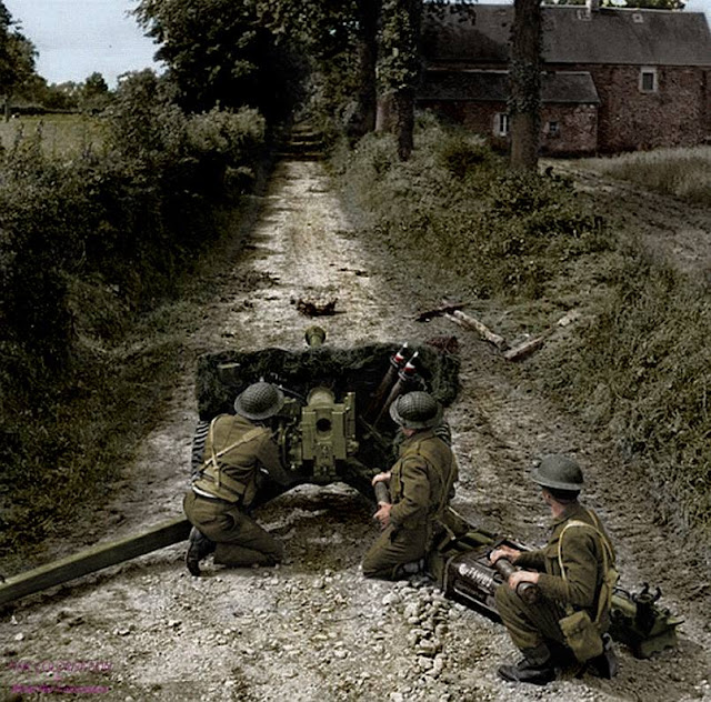 A British Soldiers from the 50th Northumbrian Division using a a anti-tank gun QF 6 57mm (6 pounder - ATK/Mk II) in an important way in the area of Lingèvres, Lower-Normandy , June 16, 1944.