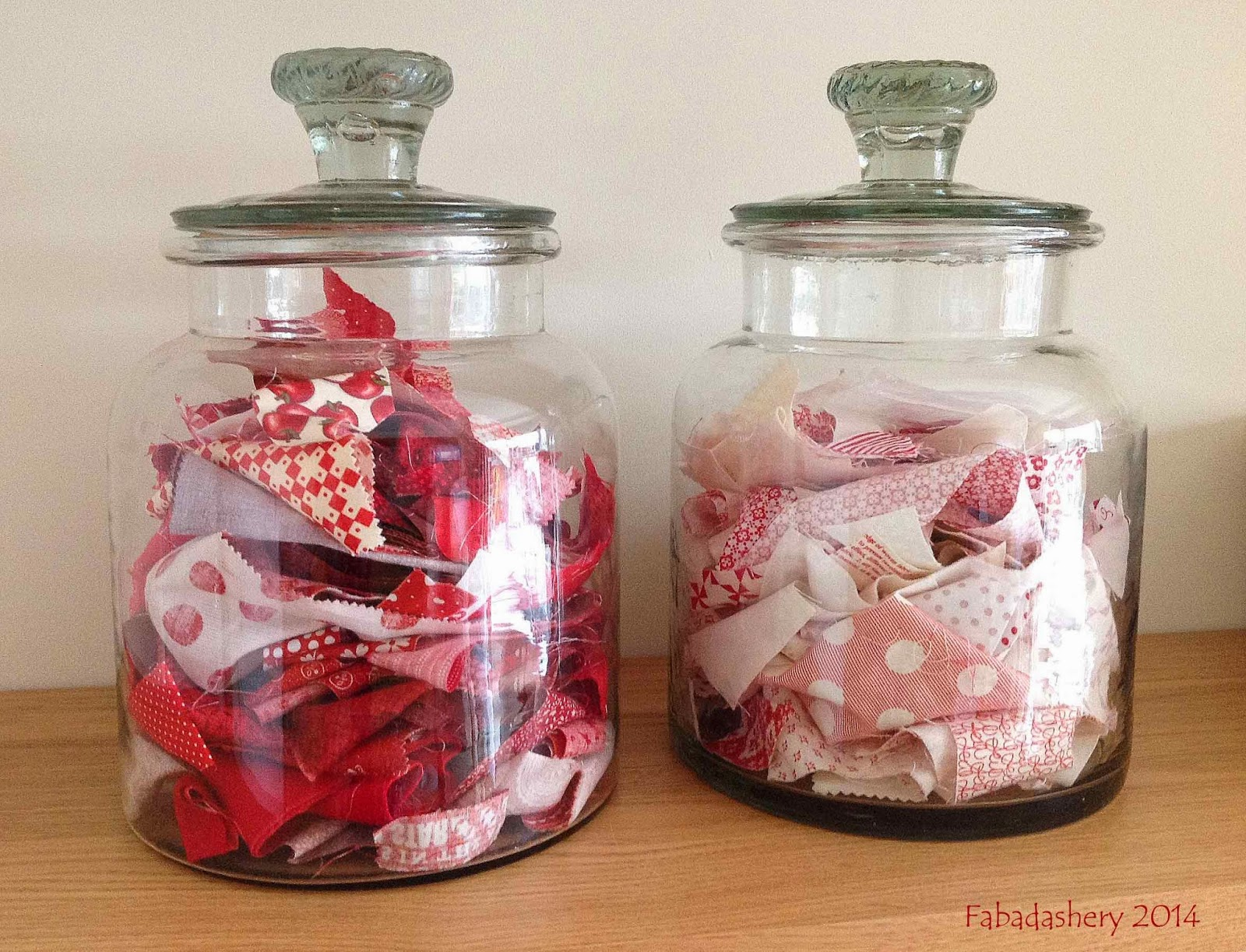 Giant sweet jars filled with fabric scraps