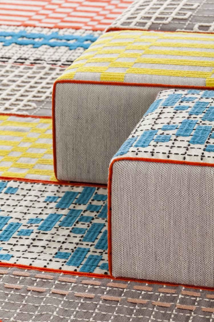 The fabric lounge chairs can be upholstered in a wide range of patterned fabrics which extend as floor coverings
