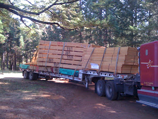 the roof trusses  can be wider than the trailer and require a wide load permit