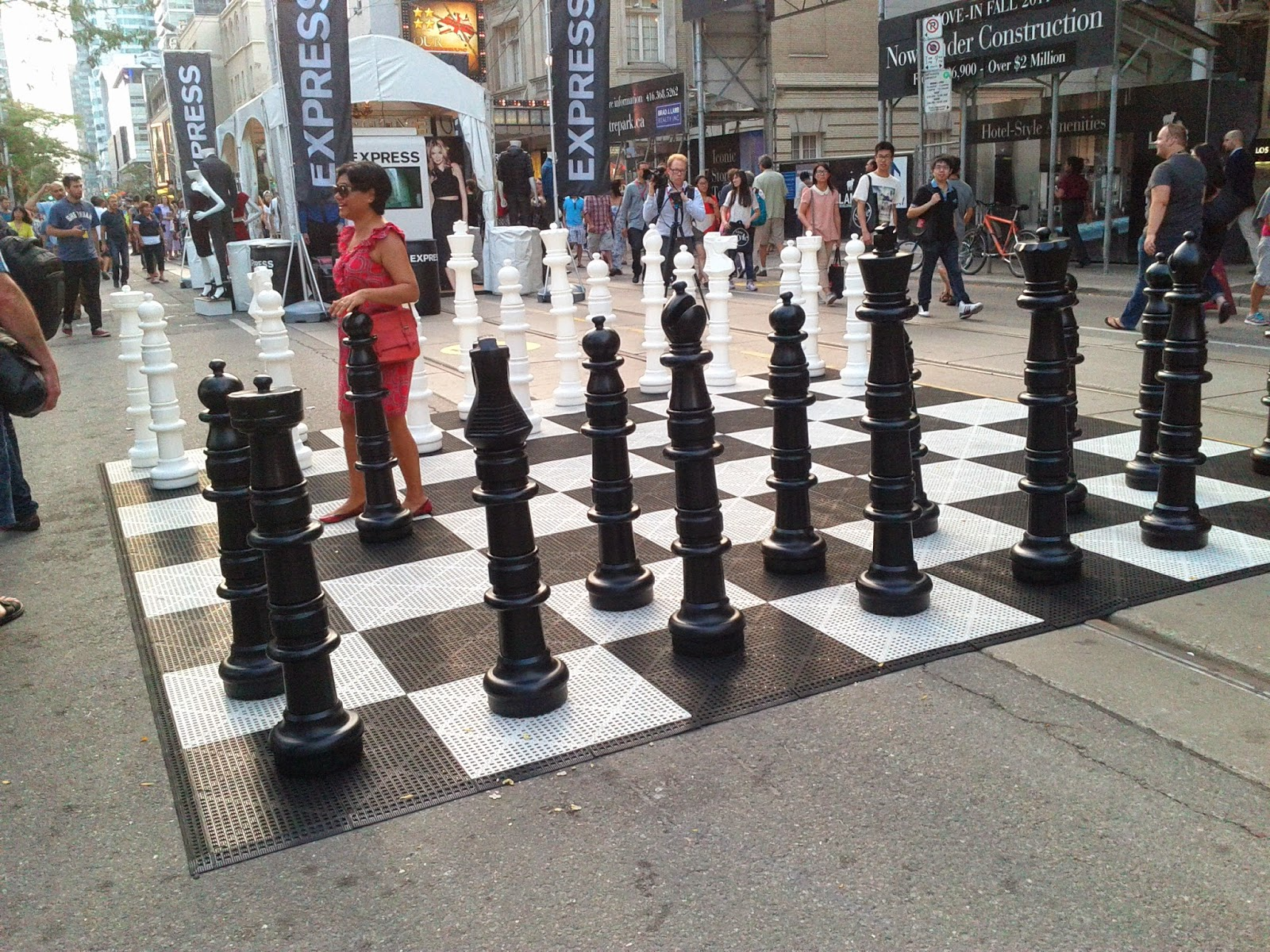 Stock Photo: Chess board and pieces human size