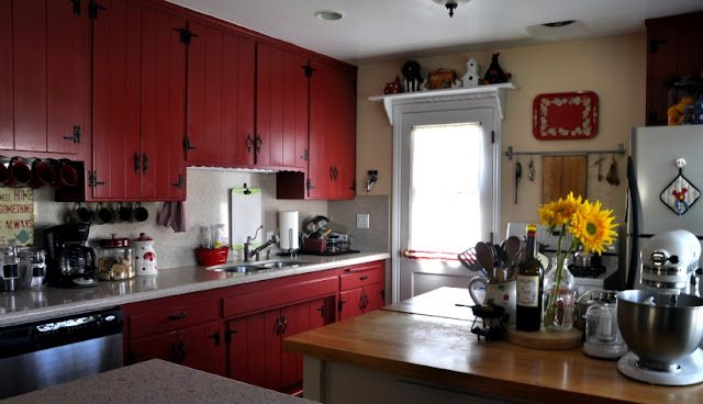If I want to pair my barn red cabinets with modern quartz counter tops