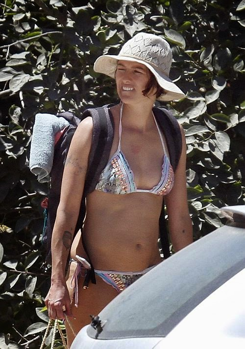 There's nothing wild when it comes to Lena Headey's style. Be a lady such holiness creature as the actress looked wholesome with a touch of rocking appeal to her stunning two-piece during a holiday in Ibiza on Friday, July 4, 2014.