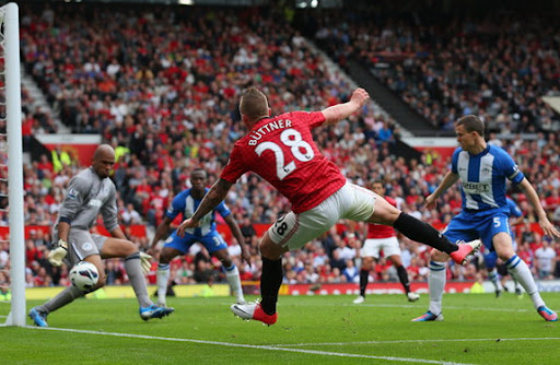 Alexander Büttner scores Manchester United's third goal against Wigan from acute angle