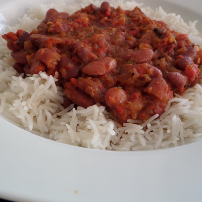 Red Beans and Rice:  A one dish meal of red kidney beans flavored with bacon and peppers served over rice.