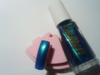 swatch layla ceramic effect golden blue