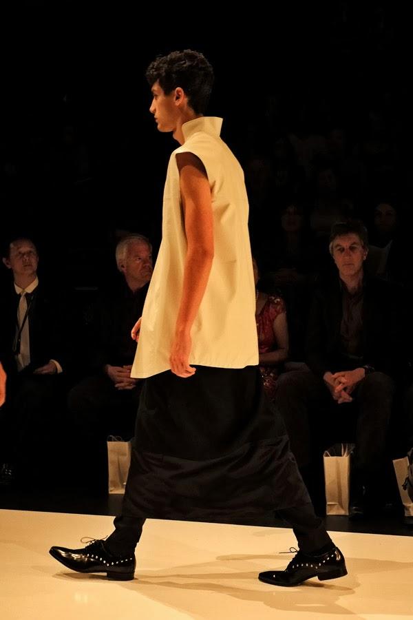David Zheng; Beatles collar sleeveless top with black skirt over black pants  - Menswear : Raffles Graduate Fashion Parade 2013 Photography by Kent Johnson.