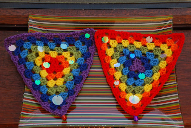 image of rainbow bunting with irridescent disc embellishment