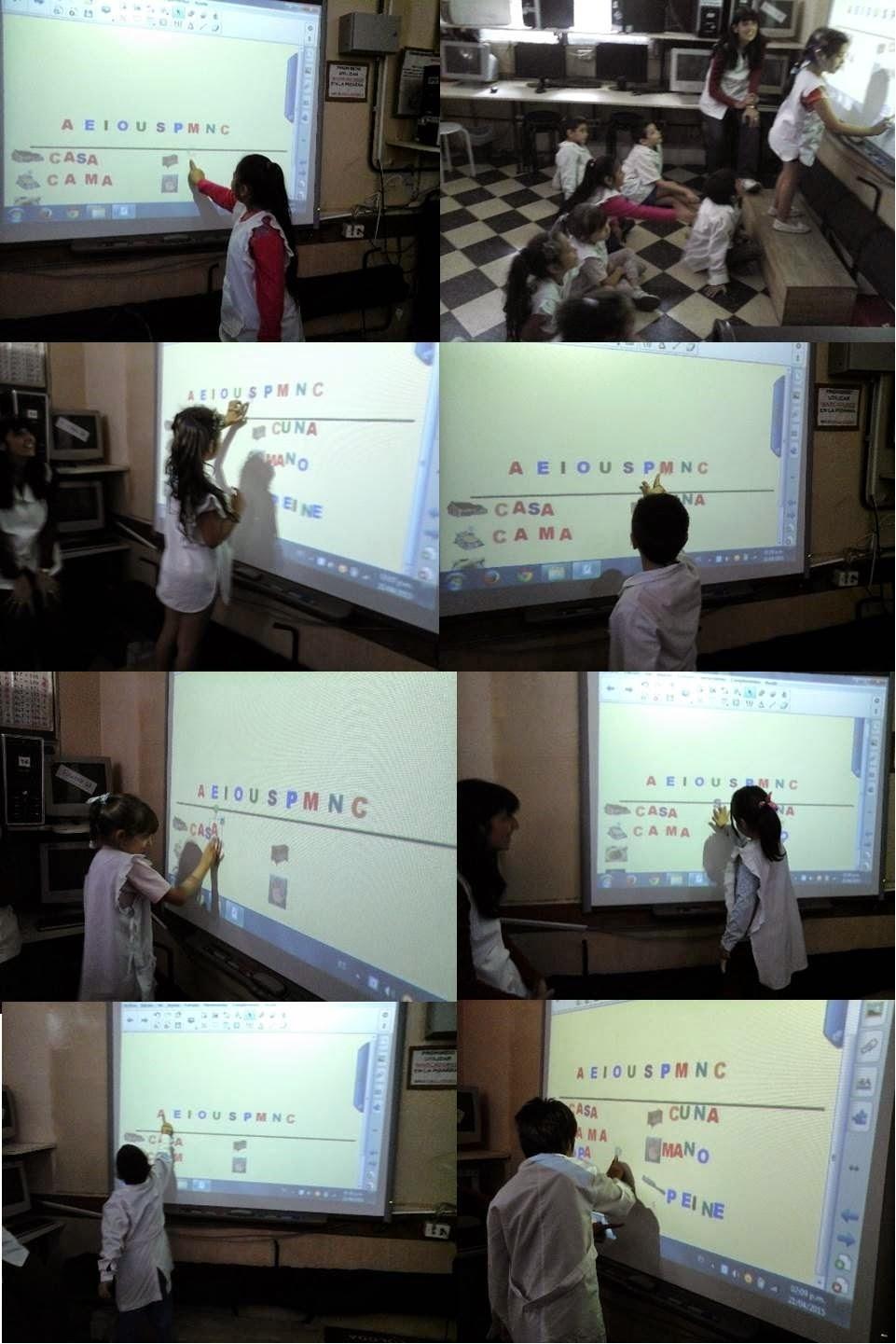 alumnos usando la pizarra digital interactiva