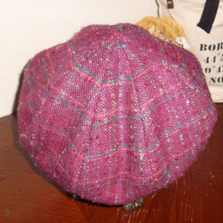 Eight-paneled crown for 'newsboy' style hat in reddish-purple plaid