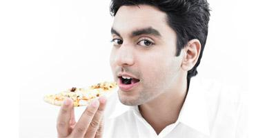 7 Ways to Defeat Food Cravings More Easily  - man eating much