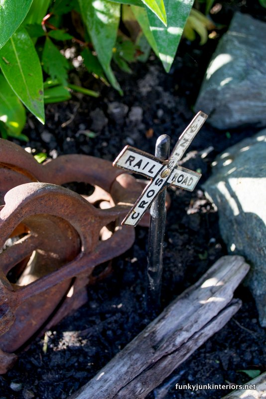 railway crossing sign in fairy garden