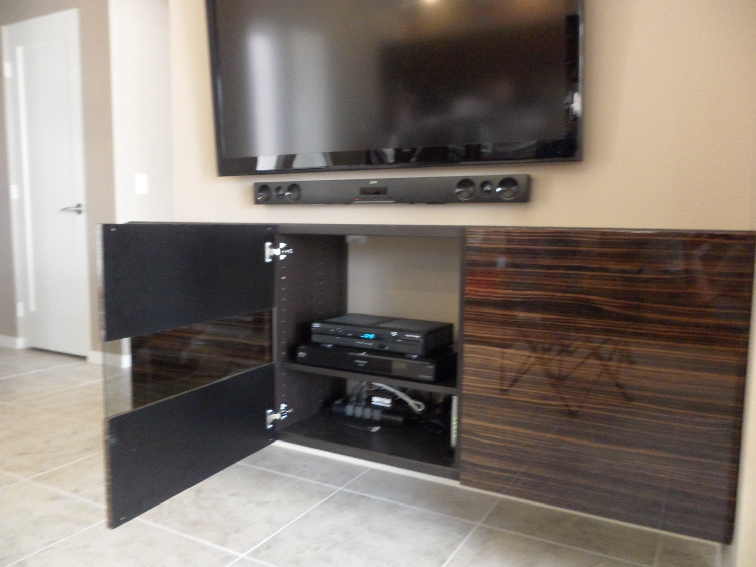 besta floating media cabinet with flat panel tv get home decorating. Black Bedroom Furniture Sets. Home Design Ideas