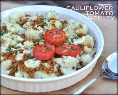 Cauliflower Tomato Medley, slices of tomato and steamed cauliflower topped with cheese and baked until warm. Low carb.