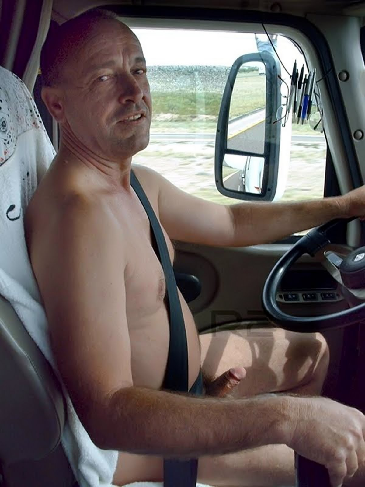 Nude men driving naked