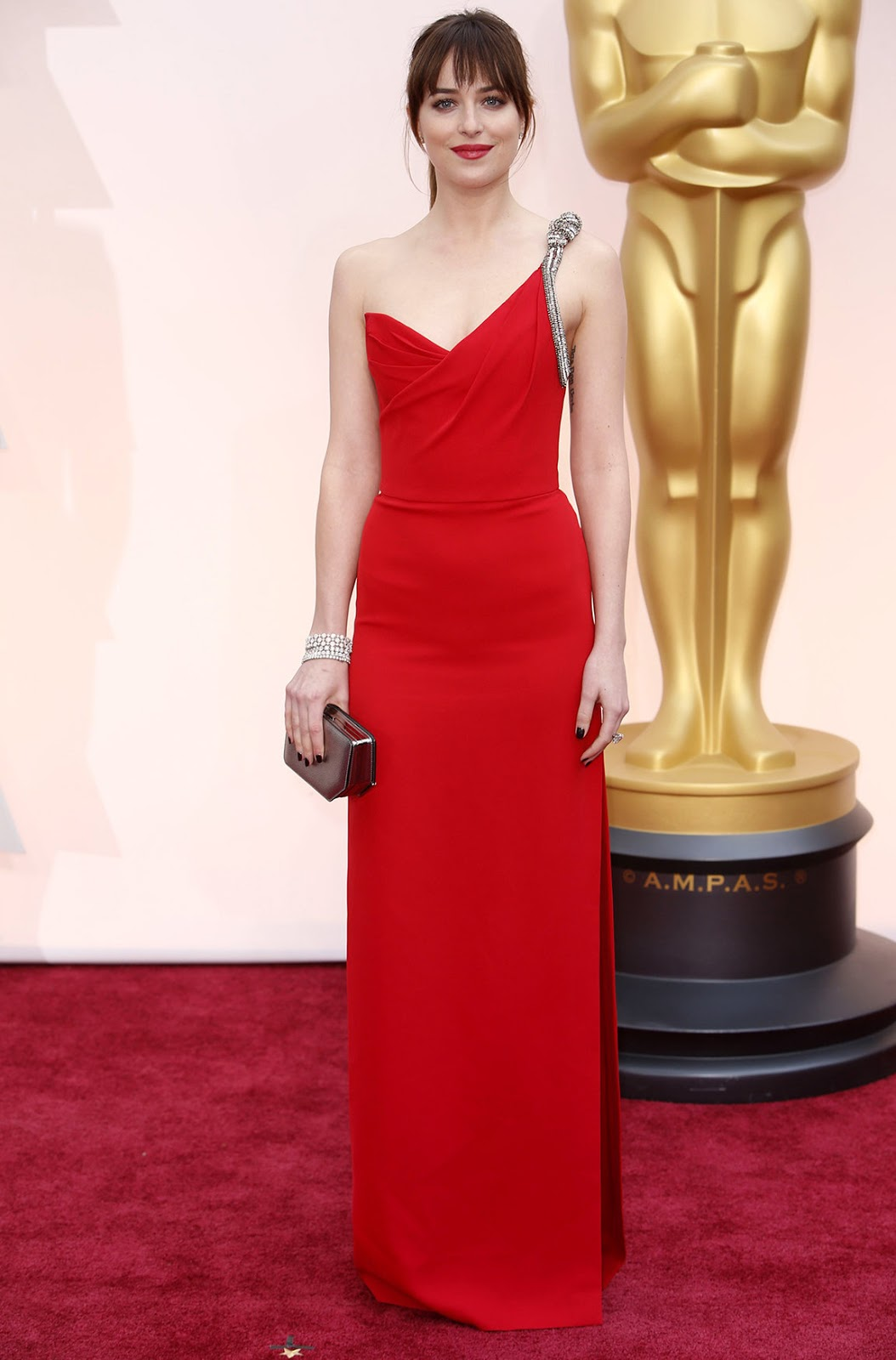Dakota Johnson in Saint Laurent at the Oscars 2015
