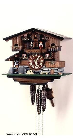Típico reloj cucú suizo con forma de chalé